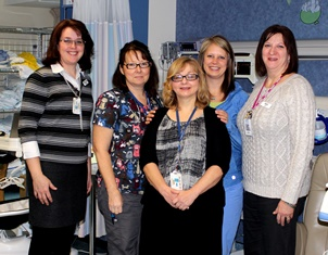Included in the photo are QHC staff who are affiliated with the Neonatal Abstinence Syndrome program
