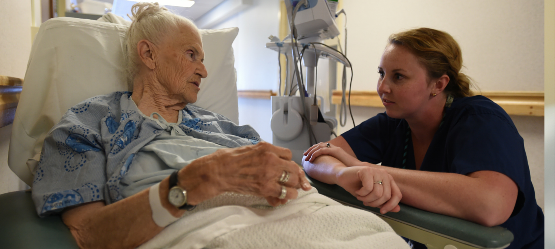 nurse caring for elderly patient