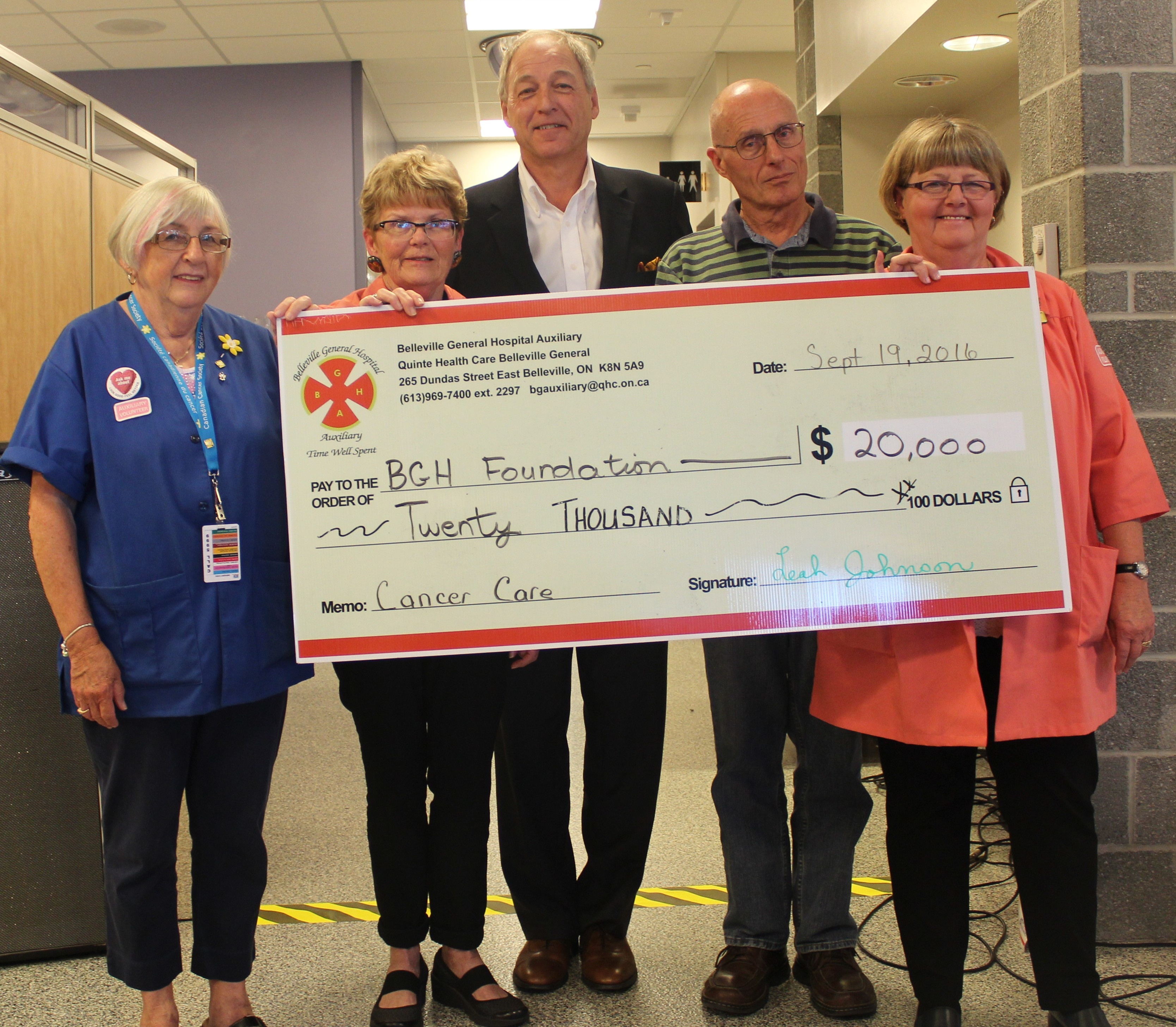 $20,000 cheque from the Auxiliary as part of the opening ceremonies